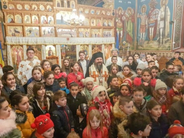 """His Grace Bishop Macarie at Copsa Mica, distributing social scholarships for poor children: """"The safest """"deposit"""" we can open is the one in the heavens that awaits its interest"""""""